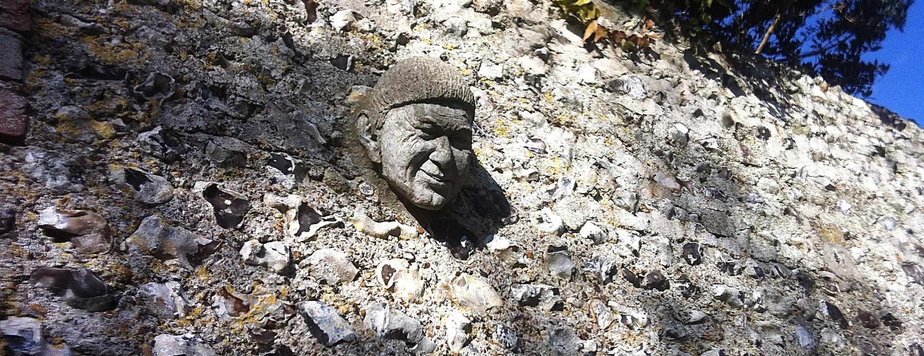 head in flint wall
